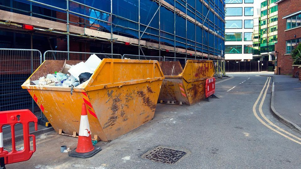 some of our skips being used on a building site